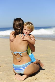 Happy Child Hugging Her Mother On The Beach Royalty Free Stock Images