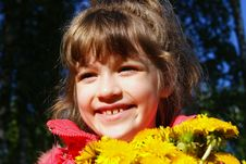 Free The Happy Girl With A Bouquet Royalty Free Stock Photo - 15031915