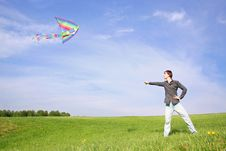 Free Young Man In Black Shirt Flying Multicolored Kite Stock Image - 15033031