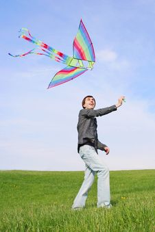 Free Young Man In Black Shirt Flying Multicolored Kite Stock Photos - 15033123