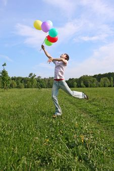 Free Young Man With Many Colored Balloons Jumping Royalty Free Stock Photos - 15033198