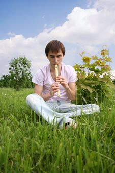 Free Young Man Playing On Flute At Summer Time Royalty Free Stock Photo - 15033375