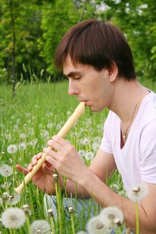Free Young Man Playing On Flute Side View Stock Image - 15033401