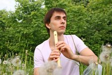 Free Young Man Playing On Flute At Summer Time Royalty Free Stock Image - 15033436