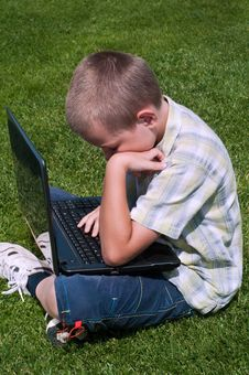 Free Boy Playing With Laptop Stock Photography - 15033442