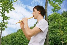 Free Young Man Playing On Flute At Summer Time Royalty Free Stock Image - 15033476