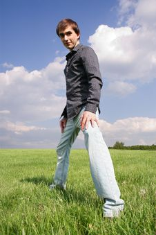 Free Young Man In Black Shirt Standing On Green Lawn Royalty Free Stock Photography - 15033597