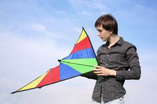 Free Young Man In Black Shirt Holding Multicolored Kite Stock Photo - 15033670