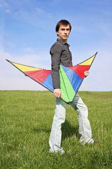 Free Young Man In Black Shirt Holding Multicolored Kite Stock Image - 15033731