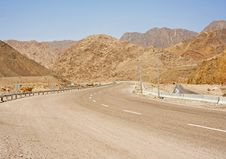 Winding Road Through Desert Mountains Royalty Free Stock Photos