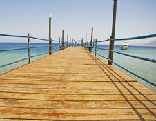 Wooden Jetty On A Tropical Beach Stock Photo
