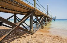 Wooden Jetty On A Tropical Beach Royalty Free Stock Image
