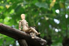 Puppet Sitting In The Woods Royalty Free Stock Photo