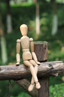 Puppet Sitting In The Woods Royalty Free Stock Photography
