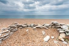 Free Stones On An Empty Beach Stock Photo - 15038060