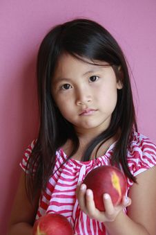 Suprised Girl With Peaches Stock Photo