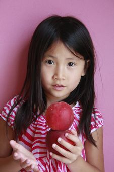 Suprised Girl With Peaches Royalty Free Stock Image