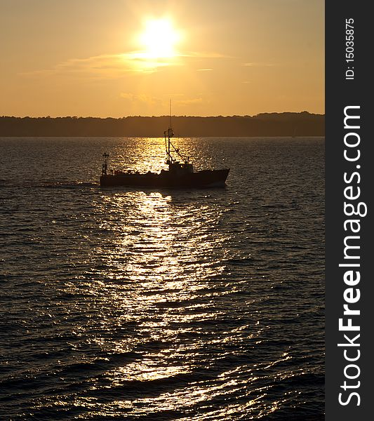 Commercial fishing boat at sunset