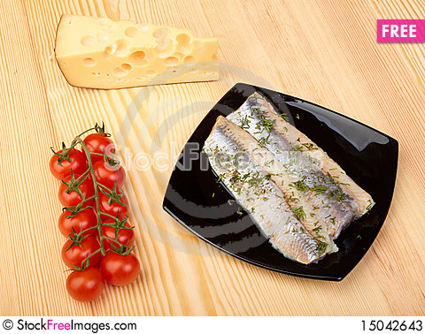Free Herring On Black Plate Stock Photos - 15042643