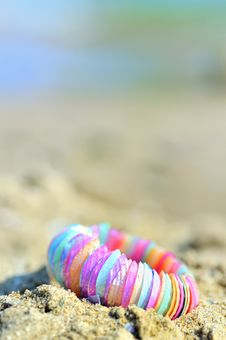 Free Shell Bracelet On Beach Royalty Free Stock Image - 15042936