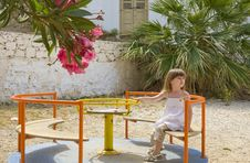 Free A Little Girl On Carousel  In Playground Royalty Free Stock Photo - 15044495
