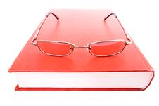 Free Glasses On A Closed Book Royalty Free Stock Image - 15044796