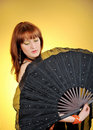 Free Beautiful Belly Dancer With Big Black Fan Stock Photos - 15059553