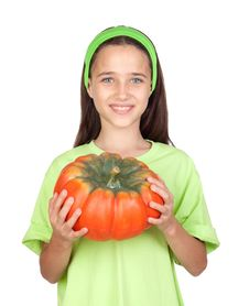 Happy Girl In Halloween With A Big Pumpkin Royalty Free Stock Image