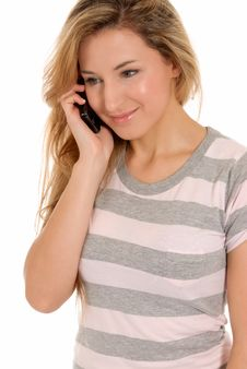 Young Female Talking By Telephone And Smiling Royalty Free Stock Photo