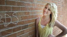 Free Girl Standing Next To Brick Wall Royalty Free Stock Photography - 15053067
