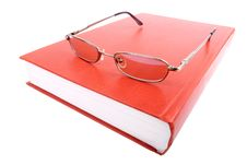 Free Glasses On A Closed Book Stock Images - 15053454