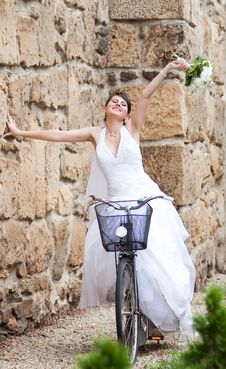 Free Happy Bride Riding A Bike Royalty Free Stock Photos - 15054098