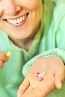 Free Woman Holds Pills In A Hand Royalty Free Stock Images - 15058239
