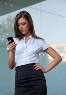 Free Young Woman With A Mobile Phone In Hands Royalty Free Stock Photos - 15059038