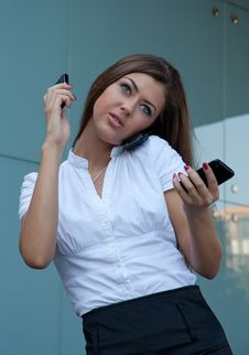 Free Young Woman Talks By Three Phones Simultaneously Royalty Free Stock Photo - 15059065