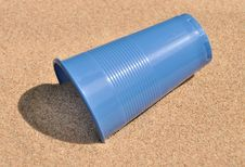 Free Plastic Glass On Sand. Stock Photo - 15059080