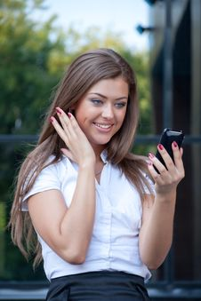Free Young Woman Looks In Phone And Rejoices Stock Image - 15059121