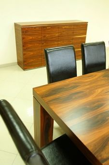 Free Wooden Table And Leather Black Chairs Stock Photos - 15059213