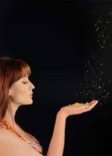 Free Young Beautiful Woman Blowing Golden Stardust Stock Photography - 15059492