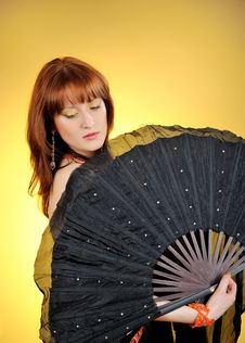 Beautiful Belly Dancer With Big Black Fan Stock Photos