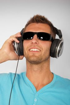 Young Man In Sunglasses With Headphones Royalty Free Stock Photo