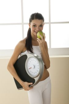 Free Young Woman Holding Weight Scale Royalty Free Stock Photography - 15060267