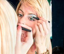 Free Nice Caucasian Model Applying Makeup With Brush Stock Photos - 15060383