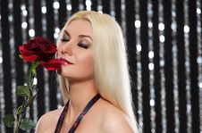 Free Blond Woman With A Rose Royalty Free Stock Photography - 15060477