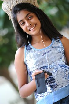 Free Beautiful Young Girl Listening To Music Stock Images - 15069954