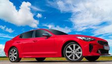 Free Red Car On A Blue Sky Background. Royalty Free Stock Photography - 150649647