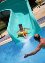 Free Father Catches Child On Water Slide Stock Photo - 15077270