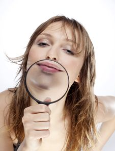 WOMAN WITH MAGNIFIER Royalty Free Stock Images