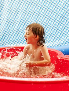 Little Girl Playing In Basin Stock Image