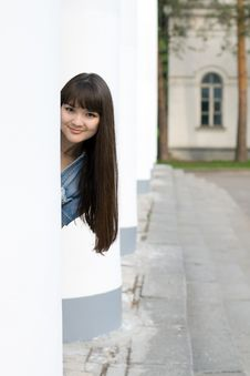 Free Girl Hiding Behind Column Stock Photography - 15074122